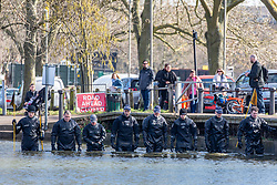 © Licensed to London News Pictures. 09/03/2021. London, UK. Members of the public watch as a specialist police diving unit searches ponds on Clapham Common this morning as the hunt for missing Londoner, Sarah Everad 33 continues. Sarah Everad from Brixton disappeared while walking home from a friend's house in Clapham and was last seen by CCTV around 9.30pm on Poynder's Road SW4 heading towards Tulse Hill. Photo credit: Alex Lentati/LNP