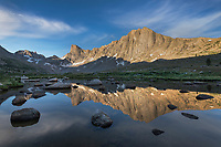 Pronghorn and Dragon Head Peaks reflected in pond near Lee Lake, Bridger Wilderness. Wind River Range, Wyoming