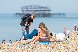 © Licensed to London News Pictures. 28/05/2018. Brighton, UK. Brighton resident, 38 year old OLGA from Russia takes advantage of the hot and sunny weather on the last day of the Bank Holiday weekend to to up her tan on the beach in Brighton and Hove. Today, Monday May 28th 2018 is predicted to be the hottest day of the year so far. Photo credit: Hugo Michiels/LNP