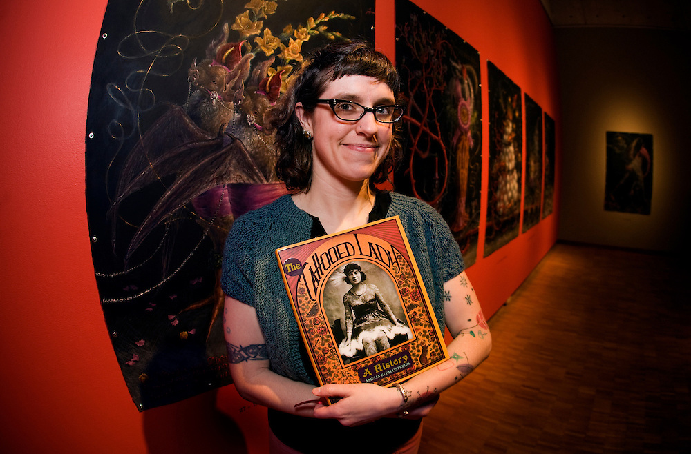 Amelia Klem Osterud poses with her new book The Tattooed Lady before giving a lecture at The Haggerty Museum of Art on Marquette University's campus.