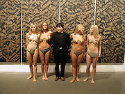 Yin Xiaofeng posing with girls. Dream: Contemporary Chinese Art in the 21st Century. Atlantis Gallery. 11 October 2001. © Copyright Photograph by Dafydd Jones 66 Stockwell Park Rd. London SW9 0DA Tel 020 7733 0108 www.dafjones.com
