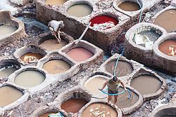 Men working in vats at the tanneries of Chouwara, Fes al Bali medina, Fes, Morocco