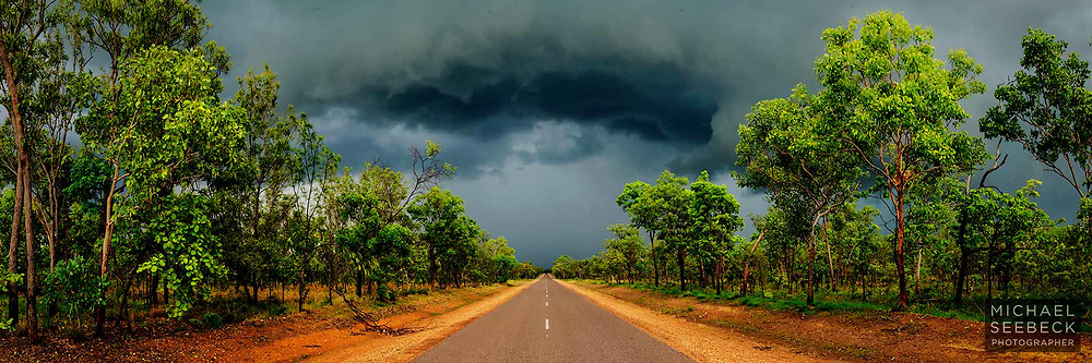 A thunderstorm's low shelf cloud advancing over the Kakadu Highway in the Top End of the Northern Territory.<br /> <br /> Limited Edition of 125 Prints