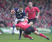 Cardiff, Wales, UK., Millennium Stadium 14th February<br /> 2004, 6 Nations, Wales vs Scotland, [Mandatory Credit; Peter Spurrier; Intersport Images],<br />  <br /> <br /> 14/02/2004  -  RBS Six Nations Championship 2004 Wales v Scotland:<br /> Simon Danielli running withe he ball is tackled by Shane Williams, Gareth Thomas running in from the back.   [Mandatory Credit, Peter Spurrier/ Intersport Images]