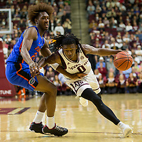 Texas A&M guard Jay Jay Chandler (0) drives in against Florida guard Deaundrae Ballard (24) of an NCAA college basketball game Tuesday, Jan. 2, 2018, in College Station, Texas. (AP Photo/Sam Craft)