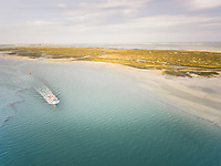 Aerial view of a boat navigating in the Formosa Lagoon in Portugal