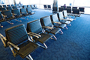 empty chairs at an JFK airport terminal
