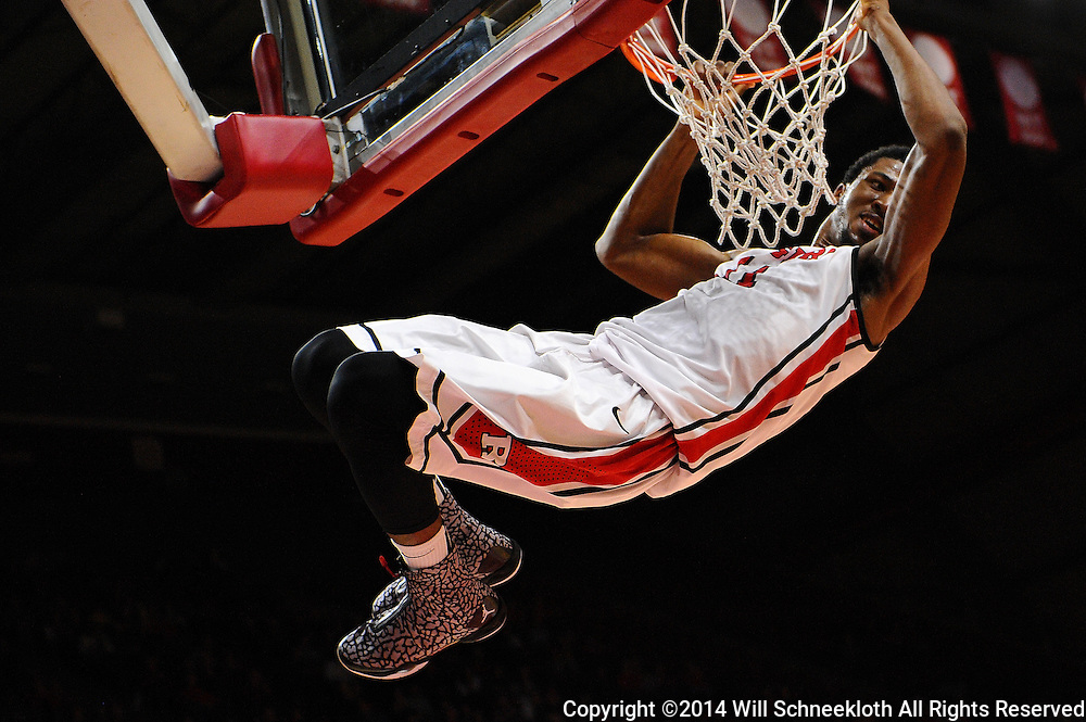 Kadeem Jack #11 of the Rutgers Scarlet Knights hangs on the rim after a slam dunk during the second half of Rutgers men's basketball vs Temple Owls in American Athletic Conference play on Jan. 1, 2014 at Rutgers Louis Brown Athletic Center in Piscataway, New Jersey.