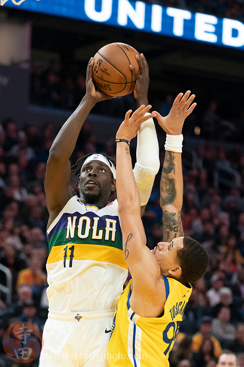 February 23, 2020; San Francisco, California, USA; New Orleans Pelicans guard Jrue Holiday (11) shoots the basketball against Golden State Warriors forward Juan Toscano-Anderson (95) during the fourth quarter at Chase Center.