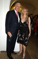 RUPERT HAMBRO and JENNY HALPERN<br /><br />at a party to celebrate the 10th anniversary of Jo Malone the perfumer held at The Banquetting House, Whitehall, London on 21st October 2004.<br /><br /><br /><br />NON EXCLUSIVE - WORLD RIGHTS