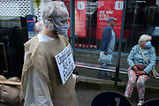 """Extinction Rebellion Penitents walking the streets of Truro to protest for climate change at Truro Cathedral in Cornwall at 11am on the 28th of August 2020 in Truro, United Kingdom. Based on the medieval idea of repenting transgressions against your community by wearing sackcloth and ashes whilst bearing your """"sins"""" around your neck. The Penitents performed in total silence in this highly visual ceremony. Starting at the Truro Park and Ride they travelled into Truro and walked in procession through the town before carrying out the ceremony. These protests are highlighting that the government is not doing enough to avoid catastrophic climate change and to demand the government take radical action to save the planet.<br /> <br /> Extinction Rebellion is a climate change group started in 2018 and has gained a huge following of people committed to peaceful protests. These protests are highlighting that the government is not doing enough to avoid catastrophic climate change and to demand the government take radical action to save the planet."""