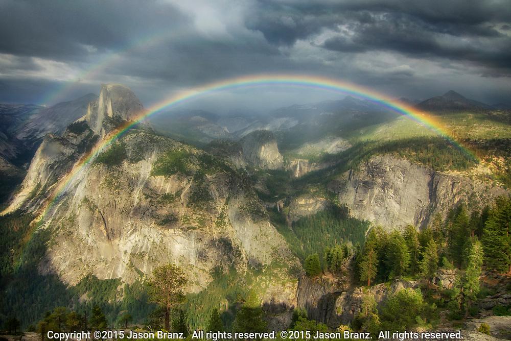 Full rainbow over Half Dome, Vernal Falls, and Nevada Falls.