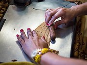 15 FEBRUARY 2020 - TAMPA, FLORIDA: Working at the Tabanero Cigar Factory and Cigar Bar in the historic Ybor City district of Tampa, Florida.     PHOTO BY JACK KURTZ