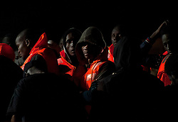 October 7, 2018 - Malaga, Spain - Migrants are seen on a rescue boat as they wait to disembark after their arrival at the Port of Malaga..Spanish Maritime Rescue service rescued 158 sub-Saharan migrants (of them, 5 minors and 43 women) aboard different dinghies at the Mediterranean Sea and brought them to Malaga Harbour, where they were assisted by the Spanish Red Cross. More than 1.100 migrants have been rescued by the Spanish authority this week. (Credit Image: © Jesus Merida/SOPA Images via ZUMA Wire)