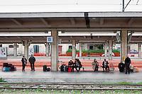 Passengers wait for the last Trinacria train. The Trinacria express train is a historical train from Palermo, Sicily, to Milan, symbol of the emigration from South to the North.  From December 11th 2011 16 train connecting Southern Italy to the North will be cancelled by Trenitalia, the state-owned train operator in Italy. ### Passeggeri aspettano l'ultimo treno Trinacria. Il Trinacria è un treno storico che ha collegato Palermo e Milano, simbolo dell'emigrazione verso Nord. Dall'11 dicembre 2011 16 treni che collegano il Sud al Nord Italia verranno soppressi da Trenitalia.