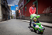 A father strolls his son on an empty street in the center of La Paz. During elections period in  Bolivia, the country faces several restrictions, like no alcohol for sale 48 hours before and 12 after the election; no public gatherings, shows of any kind until the political parties made their speeches on the election night; its completely forbidden the circulation of any vehicles, private or governmental except with the permit from the Electoral Tribunal, which means it would be basically no cars, buses or anything circulating in the city; no long distance buses, the terminal will be close from Saturday until Monday and even flights will not be allowed except the ones leaving the country or the international ones doing stop-over. It is a completely shut down of the country.