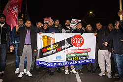 London, UK. 21st January, 2019. Hundreds of Uber minicab drivers take part in a protest outside the offices of Transport for London organised by the Independent Workers Union of Great Britain's (IWGB) United Private Hire Drivers branch following the introduction last month of congestion charges for minicabs.