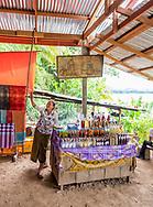 Woman selling whisky in XangHei Village near Luang Prabang.