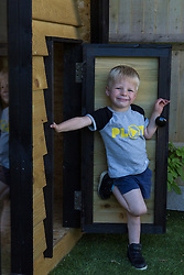 Dad of two Tom Prior has created a beautiful shingle clad, two floor play house in the garden of his Shoreham, West Sussex home for his children. Tom's son Jackson, 4, at the door to his beautifully designed and constructed shed. Shoreham, West Sussex, July 15 2019.
