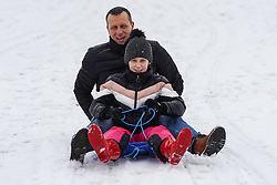 © Licensed to London News Pictures. 14/01/2021. Hexham, UK. Vannesa,10, and her dad enjoy sledging in the snow at Hexham Park following heavy snow last night. Photo credit: Ioannis Alexopoulos/LNP<br /> <br /> ***Permission Granted