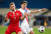 ATHENS, GREECE - OCTOBER 11: Oleg Reabciukof Moldova and Petros Mantalosof Greece during the UEFA Nations League group stage match between Greece and Moldova at OACA Spyros Louis on October 11, 2020 in Athens, Greece. (Photo by MB Media)