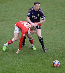 West Ham's Kevin Nolan fouls Bristol City's George Saville - Photo mandatory by-line: Alex James/JMP - Mobile: 07966 386802 - 25/01/2015 - SPORT - Football - Bristol - Ashton Gate - Bristol City v West Ham United - FA Cup Fourth Round