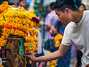 16 AUGUST 2016 - BANGKOK, THAILAND: A man prays at Erawan Shrine one year after the shrine was bombed in the worst international terrorist attack in Thai history. On 17 August 2015, a bomb was set off at the Erawan Shrine, a popular tourist attraction and important religious shrine in the heart of the Bangkok shopping district. According to the Royal Thai Police  20 people were killed in the bombing and 125 injured. Thai Police arrested an alleged Uighur extremist for the bombing. The case against him is still pending in Thai courts. The shrine was repaired, rededicated and reopened to the public on 4 September 2015.       PHOTO BY JACK KURTZ