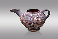 """Minoan Kamares Ware beak spouted """"teapot"""" with extended spout and  leaf polychrome decorations, Kamares Sacred Cave 1900-1700 BC; Heraklion Archaeological  Museum, grey background.<br /> <br /> This style of pottery is named afetr Kamares cave where this style of pottery was first found .<br /> <br /> If you prefer to buy from our ALAMY PHOTO LIBRARY  Collection visit : https://www.alamy.com/portfolio/paul-williams-funkystock/minoan-art-artefacts.html . Type -   Heraklion   - into the LOWER SEARCH WITHIN GALLERY box. Refine search by adding background colour, place, museum etc<br /> <br /> Visit our MINOAN ART PHOTO COLLECTIONS for more photos to download  as wall art prints https://funkystock.photoshelter.com/gallery-collection/Ancient-Minoans-Art-Artefacts-Antiquities-Historic-Places-Pictures-Images-of/C0000ricT2SU_M9w"""
