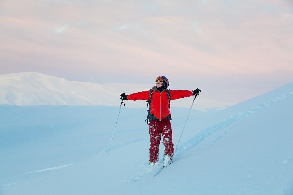 Michelle Blade ecstatic at sunset on Hallwylfjellet, Svalbard.