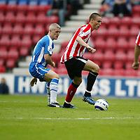 Photo: Peter Phillips.<br /> Wigan Athletic v Sunderland. The Barclays Premiership.<br /> 27/08/2005.<br /> Sunderlands Anthony le Tallec goes past Graham Kavanagh