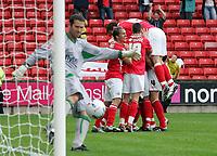 Photo: Paul Thomas.<br /> Barnsley v Southampton. Coca Cola Championship. 19/08/2006.<br /> <br /> Marc Richards and Barnsley celebrate his goal (R) while Southampton keeper Kelvin Davis kicks the ball out off his net.