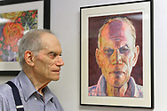 Port Washington, New York, U.S 6th October 2013. MAURICE NEWSTEIN, of Syosset, stands next to his self-portrait, a watercolor, at The Artists Reception for Members Showcase of The Art Guild of Port Washington, at The Graphic Eye Gallery.