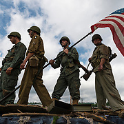 Caleb Cobb, Bryan Querrey, Alexx Cobb and Eric Voiers of the Ripley Tabernacle Baptist Church prepare to portray the Iwo Jima flag raising photo for the annual Independence Day parade in Ripley, W.Va., on July 04, 2019. (Craig Hudson/The Charleston Gazette-Mail via AP)