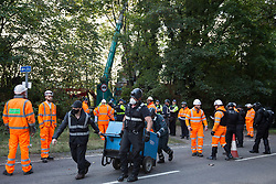 Wendover, UK. 10th October, 2021. Enforcement agents from the National Eviction Team (NET), working alongside Thames Valley Police officers, commence an operation to evict environmental activists opposed to the HS2 high-speed rail link from Wendover Active Resistance (WAR) camp. WAR camp, which contains tree houses, tunnels, a cage and a 15-metre tower, is currently the largest of the protest camps set up by Stop HS2 activists along HS2's Phase 1 route between London and Birmingham.