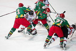 Christoph Herzog of Austria between Benas Silinskas and Lukas Manomaitis of Luthuania, Marius Krikstanaitis of Lithuania vs Fabio Hofer of Austria  during the ice hockey match between National teams of Lithuania (LTU) and Austria (AUT) at 2011 IIHF World U20 Championship Division I - Group B, on December 12, 2010 in Ice skating Arena, Bled, Slovenia.  (Photo By Vid Ponikvar / Sportida.com)
