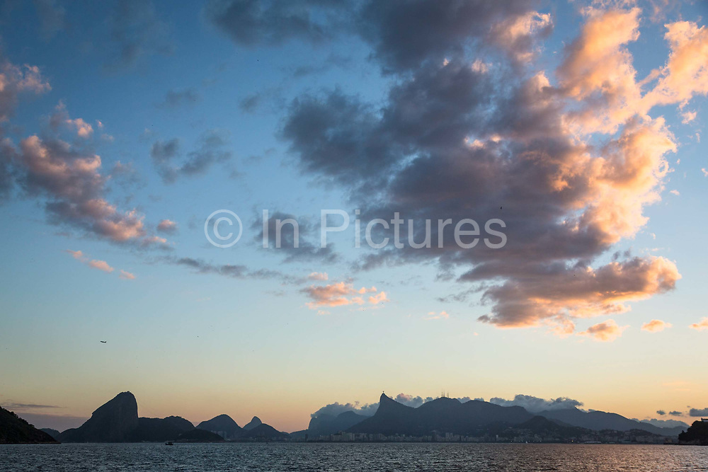 View of the Guanabara bay, Christ the Reedemer statue and the Sugar Loaf mountain from Niteroi beach, Rio de Janeiro.