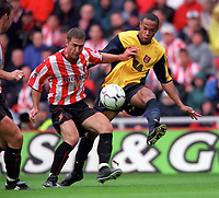 Thierry Henry (Arsenal) challenged by Chris Makin (Sunderland). Sunderland 1:0 Arsenal. FA Premiership,19/8/2000. Credit Colorsport / Stuart MacFarlane.