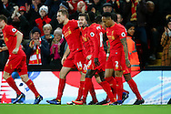 Adam Lallana of Liverpool (c) celebrates with his teammates after scoring his teams 1st goal. Premier League match, Liverpool v West Ham Utd at the Anfield stadium in Liverpool, Merseyside on Sunday 11th December 2016.<br /> pic by Chris Stading, Andrew Orchard sports photography.