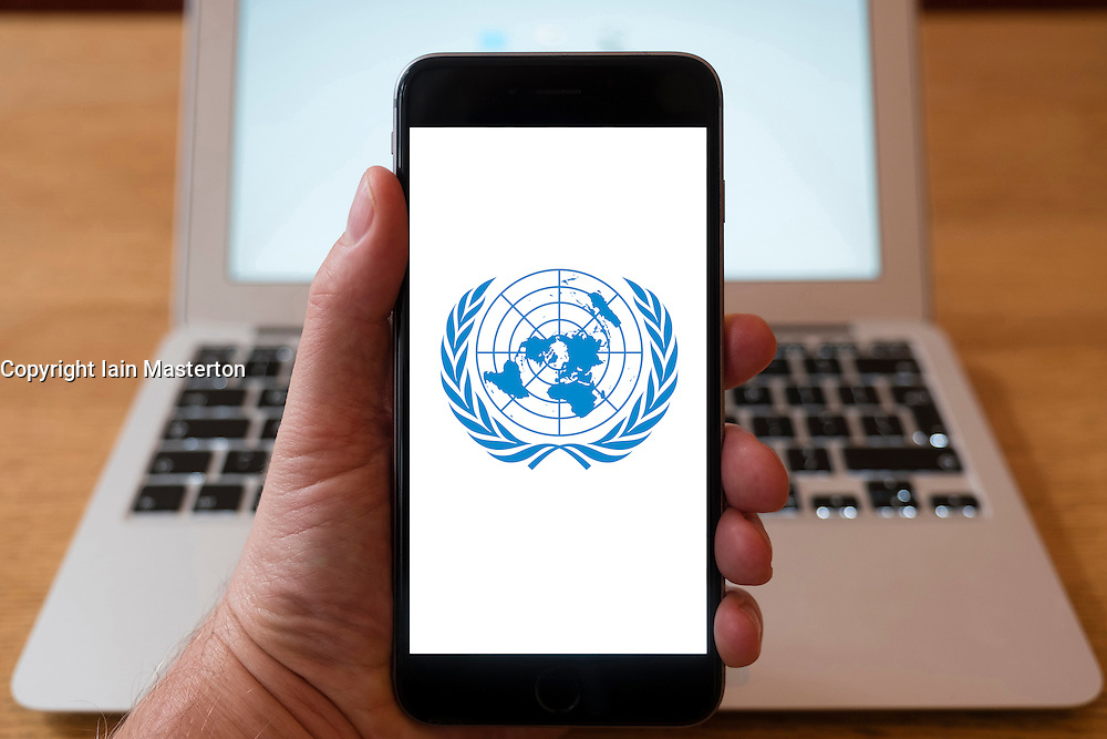 Using iPhone smartphone to display logo of the United Nations,