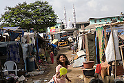 Children are playing inside the slum next to Bandra (East) train station, Mumbai, India, near the home of child actors Azharuddin Ismail and Rubina Ali, playing the roles of 'young Salim' and 'young Latika' in the movie Slumdog Millionaire, winner of 8 Oscar Academy Awards in December 2008. Various promises were made to lift the two young actors from poverty and slum-life but as of the end of May 2009 anything is yet to happen. Rubina's house was recently demolished with no notice as it lay on land owned by the Maharashtra train authorities and she is now permanently living with her uncle's family in a home a stone-throw away in the same slum. Azharuddin's home too was demolished in the past two weeks, as it happens every year in his case, because the concrete walls were preventing local authorities to clear a drain passing right behind it. As usual, his father is looking into restoring the walls as soon as the work on the drain has been completed.
