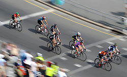 Cape Town - 180311 - Riders cycling past Seapoint Promanade. Nolan Hoffman (Team BCX) won the Cape Town Cycle Tour in spectacular fashion today. Hoffman out-sprinted Sam Gaze (Investec-Songo-Specialized) and Reynard Butler (Pro Touch) to win his third title in a time of 02:37:30. The women's race saw a pioneering first when they started in Glencairn to have 76 kilometre race. This ensured a clear run all the way to the finish and it was epic. In the end, Kim Le Court (Demacon) took the bunch sprint ahead of Namibia's Vera Adrian (DormaKaba) and track star Maroesjka Matthee (Ciovita). Photographer: Armand Hough/African News Agency/ANA