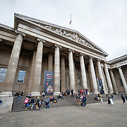 Visitors enter the main entrance to the British Museum in downtown London. The museum is dedicated to human history and culture and has about 8 million works in its permanent collection.