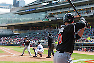 Justin Ruggiano #20 of the Miami Marlins waits on-deck against the Minnesota Twins in Game 1 of a split doubleheader on April 23, 2013 at Target Field in Minneapolis, Minnesota.  The Twins defeated the Marlins 4 to 3.  Photo: Ben Krause