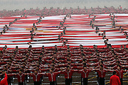 ZHENGZHOU, CHINA - NOVEMBER 10: (CHINA OUT) <br /> <br /> Is this China's answer to winning the World Cup? Chinese city establishes a 'Shaolin Soccer' academy that incorporates kung fu into its football regime<br /> <br /> <br /> Is this China's answer to winning the World Cup? Chinese city establishes a 'Shaolin Soccer' academy that incorporates kung fu into its football regime<br /> <br />     35,000 students currently train at the Shaolin Tagou Martial Arts School<br />     100 male and female students chosen from those are in the new academy<br />     The camp is based in Dengfeng, China, and will mix kung fu and football<br /> <br /> By Chloe Lyme For Mailonline<br /> <br /> Published: 18:29, 12 November 2015 | Updated: 18:40, 12 November 2015<br /> <br /> 7<br /> shares<br /> <br /> 7<br /> <br /> View comments<br /> <br /> One hundred young footballers have taken training to new extremes at the historic Shaolin Tagou Martial Arts School in east China's Dengfeng city, Henan Province.<br /> <br /> The coaching base opened a new football academy on November 10, which will combine Shaolin kung fu with football, 35,000 students currently train at the school but only 100 of those will be chosen to enter the academy. It's intended to become China's way of improving its footballers. The are two classes, split into male and female, with 50 pupils in each. All of the students are aged 10 to 12.<br /> <br /> Children who attend the football training have been specifically chosen from the martial arts school, so they are already young kung fu masters in the making.<br /> <br /> They know every aspect of the art, which consists of stamina, flexibility, balance, meditation and combat skills.<br /> The academy is equipped with three senior football coaches responsible for training the young athletes and junior coaches.<br /> <br /> Training is motivated by the 'great three-five-eight battle plan.'<br /> <br /> They expect to see massive improvements in three years, success in five, and to be an established brand in eight years.<br /> <br /> Mixing football and kung fu together is a bid to strengthen the standards of the game in China. It is well-known across the globe that Chines