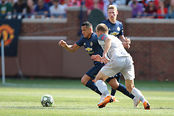 July 28, 2018 - Ann Arbor, Michigan, United States - Alexis Sanchez (7) of Manchester United rushes to the ball under the pressure of Ragnar Klavan (17) of Liverpool during an International Champions Cup match between Manchester United and Liverpool at Michigan Stadium in Ann Arbor, Michigan USA, on Wednesday, July 28,  2018. (Credit Image: © Amy Lemus/NurPhoto via ZUMA Press)
