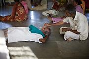 Selvaraj pinches Venugopal's nose before an exercise class at the Tamaraikulum Elders village, Tamil Nadu, India