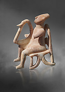 The 'Harpist of Keros' a seated parian marble female Cycladic figurine. Early Cycladic Period II (2800-2300 BC) from Keros, Cat no 3908. National Archaeological Museum, Athens.   Gray background.<br /> <br /> <br /> This elaborate three dimesional Cyladic statue known as the 'Harpist of Keros' depicts a seated figure plaung a harp. Its execution required an experienced workshop that could file away the parian marble with gronze tools. .<br /> <br /> If you prefer to buy from our ALAMY PHOTO LIBRARY  Collection visit : https://www.alamy.com/portfolio/paul-williams-funkystock/cycladic-art-artefacts.html Type into the LOWER SEARCH WITHIN GALLERY box to refine search by adding background colour, place, museum etc<br /> <br /> Visit our CYCLADIC CIVILISATIONS PHOTO COLLECTIONS for more photos to download or buy as wall art prints https://funkystock.photoshelter.com/gallery-collection/Cycladic-civilisation-Ancient-Greek-Artefacts-art-Photos-Pictures-Images/C0000CmevVvnC.XU