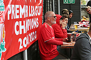 Fans celebrate outside the stadium and through the city before and during the Premier League match between Liverpool and Aston Villa at Anfield, Liverpool, England on 5 July 2020.
