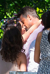 So soon after his divorce from Fergie, Josh Duhamel is seen getting married to Megan Fox. However, this was just a scene for their upcoming movie Talk Like A Dog. The two looked so in love as they were filmed having their first dance and sharing a very passionate kiss. Megan wore a white, lacy, floral wedding dress with a flower head piece and white shoes. Josh fashioned a pink, linen long sleeve shirt and beige, linen pants. 06 May 2018 Pictured: Megan Fox, Josh Duhamel. Photo credit: MEGA TheMegaAgency.com +1 888 505 6342