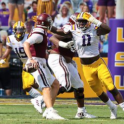 Sep 26, 2020; Baton Rouge, Louisiana, USA; LSU Tigers defensive lineman Ali Gaye (11) sacks Mississippi State Bulldogs quarterback K.J. Costello (3) during the first half at Tiger Stadium. Mandatory Credit: Derick E. Hingle-USA TODAY Sports